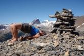 Jenny in Bridge Pose (Setu Bandha Sarvangasana) on the summit of Paget Peak in Yoho National Park, B.C. (Photo by Ian Hatter)
