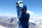 Jenny in Eagle Pose (Garudasana) on the summit of Mount Temple (elev 3,544 m  or 11,627 ft), near Lake Louise in Banff National Park, Alberta (Photo by Ian Hatter).