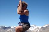 Jenny in Eagle Pose (Garudasana) atop Paget Peak, Yoho National Park, B.C. (Photo by Ian Hatter)