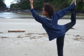 The full expression of Dancer Pose involves rising upwards and straightening the torso, as Kayla Bowers illustrates so beautifully at Schooner's Cove Beach, Pacific Rim National Park, Vancouver Island, B.C.  Another even more challenging version involves using both hands to reach back to hold the extended foot (Photo by Jenny Feick).