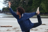 Kayla Bowers executes Dancer's Pose (Natarajasana) with grace and dignity at Schooner's Cove Beach, Pacific Rim National Park, Vancouver Island, B.C. (Photo by Jenny Feick).