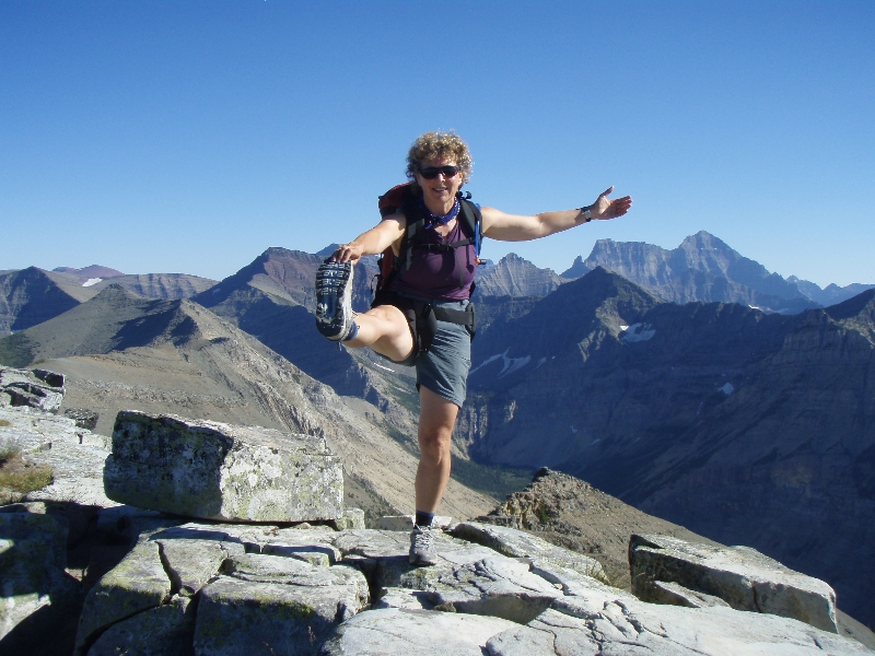 Jenny in position one of the full Standing Extended Hand to Big Toe Pose (Utthita Hasta Padangustasana) atop Vimy Peak in Waterton Lakes National Park, Alberta (Photo by Ian Hatter).