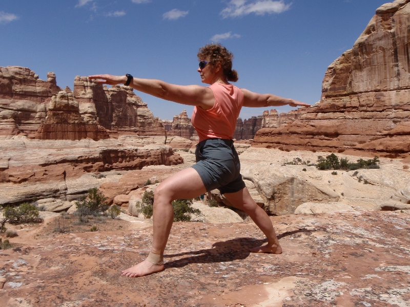Jenny in Warrior Two Pose (Virabhadrasana II) in the Needles area of Canyonlands National Park, Utah (Photo by Ian Hatter).
