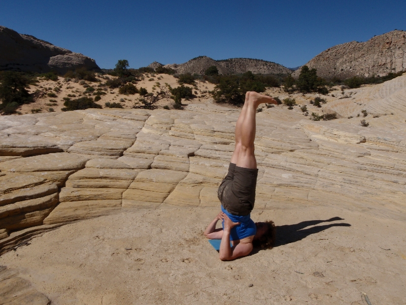 Jenny in Shoulderstand (Sarvangasana) in Snow Canyon State Park, Utah (Photo by Ian Hatter).