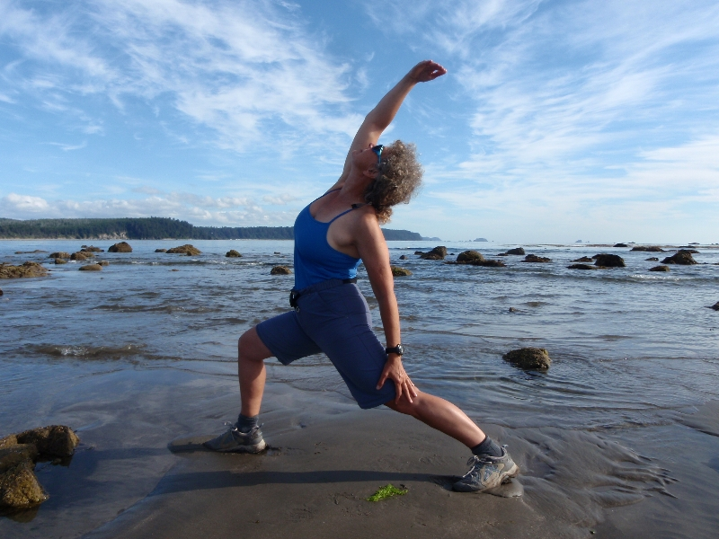 Jenny in Exalted Warrior (Viparita Virabhadrasana) at Sand Point Beach, Olympic National Park, Washington State (Photo by Ian Hatter).