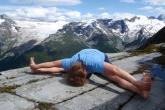Jenny in Seated wide Legged Forward Fold (Upavistha Konasana) on Abbot Ridge, Glacier National Park, B.C.  (Photo by Ian Hatter).