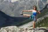 Jenny in Standing Extended Hand to Big Toe Pose (Utthita Hasta Padangustasana) on the Stanley Glacier Trail, Kootenay National Park, B.C. (Photo by Ian Hatter).