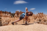 Jenny in Revolved Prayer Twist (Parivritta Parsvokonasana) at Bryce Canyon National Park, Utah (photo by Ian Hatter)