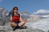 Jenny meditating in Easy Pose (Sukasana) with Chin Mudra along the Abbot Ridge Trail, Glacier National Park, B.C. (Photo by Ian Hatter)