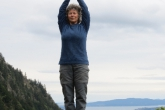 Jenny in Mountain Pose with arms extended overhead, palms together (Utthita Hasta in Tadasana) near the summit of Mount Tzouhalem, Vancouver Island, B.C. (Photo by Ian Hatter).