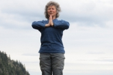 Jenny in Equal Standing Pose with hands in prayer position (Samastitihi) near the summit of Mount Tzouhalem, Vancouver Island, B.C. (Photo by Ian Hatter).