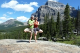 Ian and Jenny in Double Tree Pose (Vriksasana) near the Giant Steps along the Paradise Valley Trail below Mount Temple, in Banff National Park, Alberta (Photo by Gwen Smiley).