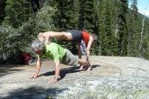 Ian and Jenny in Double Plank Pose (Yugalaka Adho Vitiyasana) near the Giant Steps along the Paradise Valley Trail, in Banff National Park, Alberta (Photo by Gwen Smiley).