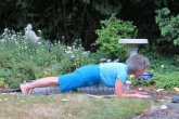 Jenny in Dolphin Plank (Makara Adho Mukha Svanasana) in her garden in Victoria, Vancouver Island, British Columbia (Photo by Ian Hatter).