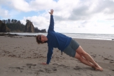 Jenny in Side Plank Pose (Vasisthasana) looking up, on Second Beach, Olympic National Park, Washington State (Photo by Ian Hatter).