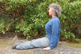Jenny in Staff Pose (Dandasana) near the summit of Mount Tzouhalem, Vancouver Island, B.C. In this posture-improving position, one can imagine one's spine as the staff (Photo by Ian Hatter).