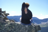 Jenny with arms in Cow Faced Pose position (Gomukasana), on Second Bald Hill, Jasper National Park, Alberta (Photo by Ian Hatter).