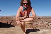 Jenny in Figure Four Pose (Eka Pada Utkatasana) in the Needles section of Canyonlands National Park, Utah (Photo by Ian Hatter).