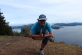 Jenny in Figure Four Pose (Eka Pada Utkatasana) on Mount Galliano, Galliano Island, B.C. (Photo by Ian Hatter).