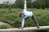 Jenny getting into Triangle Pose (Trikonasana), gaze down, at the headwaters of the Elbow River, Elbow-Sheep Wild Land Provincial Park, Kananaskis Country, Alberta (Photo by Ian Hatter).