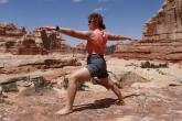 Jenny in Warrior Two Pose (Virabhadrasana II) in the Needles area of Canyonlands National Park, Utah (Photo by Ian Hatter).