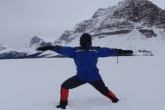 Jenny in Warrior Two Pose (Virabhadrasana II) on a snow and ice covered Bow Lake, headwaters of the Bow River, Banff National Park.  It was minus 27 degrees Celcius when this picture was taken, proving a dedicated yogi can still do outdoor yoga even during a Canadian winter (Photo by Ian Hatter).