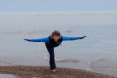 Jenny in Warrior Three Pose (Virabhadrasana III) at the very tip of Point Pelee on Lake Erie, the southernmost part of mainland Canada, Point Pelee National Park, Ontario (Photo by Ian Hatter).