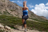 Jenny was inspired to do Eagle Pose (Garudasana) near Dolomite Pass, Banff National Park as there was a Golden Eagle flying overhead.  (Photo by Ian Hatter)