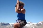 Jenny in Eagle Pose (Garudasana) atop Paget Peak, Yoho National Park, B.C. (Photo by Ian Hatter)
