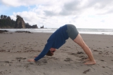 Jenny in Downward Facing Dog (Adho Mukha Svanasana) along Second Beach in Olympic National Park, Washington (Photo by Ian Hatter).