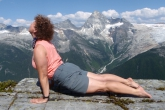 Jenny in Upward Facing Dog (Urdvah Mukha Svanasana) on Abbot Ridge in Glacier National Park, B.C.  across from Mount Sir Donald (Photo by Ian Hatter).