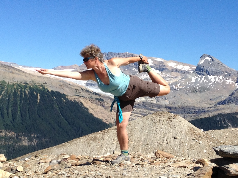 Jenny in Lord of the Dance Pose (Natarajasana) along the Iceline Trail in Yoho National Park, B.C. The full expression of this pose involves rising upwards and straightening the torso, sometimes with both hands reaching back to hold the extended foot (Photo by Ian Hatter).