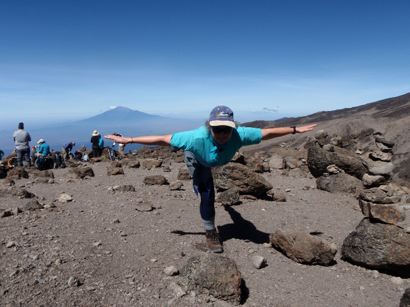 Jenny in Warrior Three Pose (Virabhadrasana III) at 15,260 feet above sea level above Barafu Camp on Mount Kilimanjaro, Tanzania, Africa (Photo by Ian Hatter).