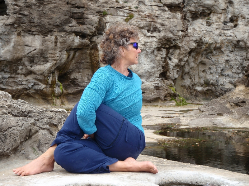 Jenny doing Half Lord of the Fishes Pose (Ardha Matsyendrasana) with a bind at Botanical Beach, Juan de Fuca Provincial Park, Vancouver Island, B.C. (Photo by Ian Hatter).