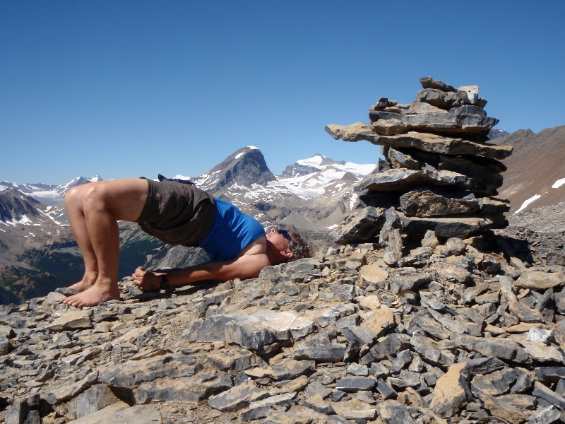 Jenny in Bridge Pose (Setu Bandha Sarvangasana) on the summit of Paget Peak in Yoho National Park, B.C. (Photo by Ian Hatter)