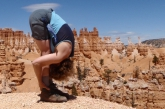 Jenny in Standing Forward Bend Pose (Uttanasana), feet hip width apart and hands on ankles variation, Bryce Canyon National Park, Utah. (Photo by Ian Hatter)