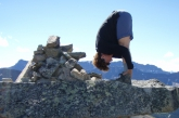 Jenny in a basic Standing Forward Bend Pose (Uttanasana), feet hip width apart and hands on ankles variation, on the Second (Upper) Bald Hill in Jasper National Park, Alberta. (Photo by Ian Hatter).