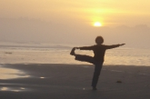 Jenny in Standing Extended Hand to Big Toe Pose (Utthita Hasta Padangustasana) on Long Beach, Pacific Rim National Park, Vancouver Island, B.C. (Photo by IanHatter)