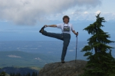 Jenny in Standing Extended Hand to Big Toe Pose (Utthita Hasta Padangustasana) with a little help from a hiking pole on Mt Beecher, Strathcona Provincial Park, Vancouver Island, B.C. (Photo by Ian Hatter).