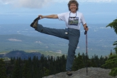 A closer view of Jenny in Standing Extended Hand to Big Toe Pose (Utthita Hasta Padangustasana) with a little help from a hiking pole on Mt Beecher, Strathcona Provincial Park, Vancouver Island, B.C. (Photo by Ian Hatter).