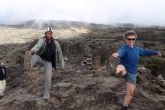 During a short break on the climb up Mount Kilimanjaro, Tanzania, Jenny taught our Assistant Guide Raymond Stephen Kanyama how to do position one of the full Standing Extended Hand to Big Toe Pose (Utthita Hasta Padangustasana) (Photo by Ian Hatter).