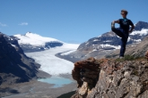 Jenny in position one of the full Standing Extended Hand to Big Toe Pose (Utthita Hasta Padangustasana) on Parker Ridge, with the Saskatchewan Glacier behind, Banff National Park, Alberta (Photo by Ian Hatter).