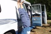 Jenny doing a supported Handstand or Downwards Facing Tree Pose (Adho Mukha Vrksasana), beside a camper van at the campsite on the Olympic Peninsula, Washington State.  As you gain confidence, gradually learn to move away from the solid object you are using for support and use your body alignment as your solid foundation (Photo by Ian Hatter)