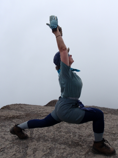 Jenny in High Lunge (Ashwa Sanchalanasana) atop the Barranco Wall (13,600 feet above sea level) on Mount Kilimanjaro, Tanzania (Photo by Ian Hatter).