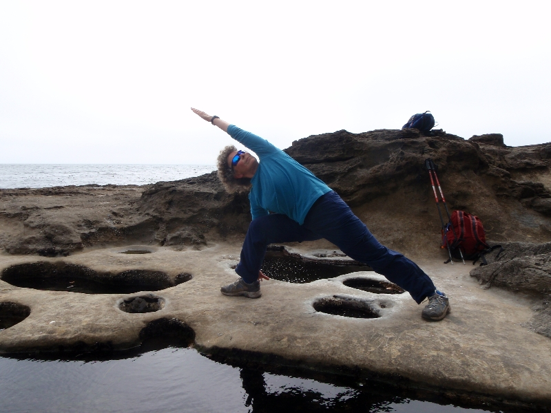 Jenny in Extended Side Angle Stretch (Utthita Parsvakonasana) at Botanical Beach, Juan de Fuca Provincial Park, Vancouver Island, B.. (Photo by Ian Hatter).
