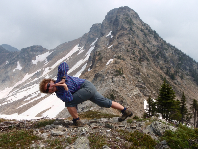 Jenny in Revolved Prayer Twist (Parivritta Parsvokonasana) on ridge above Jade Pass in Mount Revelstoke National Park, B.C. (Photo by Ian Hatter)