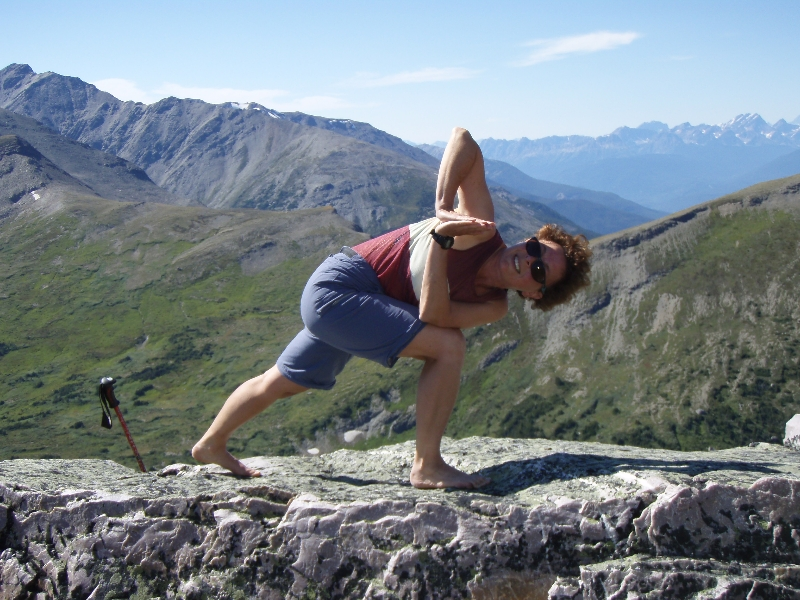 Jenny in Revolved Prayer Twist (Parivritta Parsvokonasana) on Whistler Mountain, Jasper National Park, Alberta (Photo by Ian Hatter).