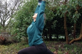 Jenny in High Lunge (Ashwa Sanchalanasana) in her yard at home in Esquimalt (Victoria), B.C. (Photo by Ian Hatter).