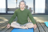 Ian meditating in Accomplished Pose (Siddasana) on a cabin deck at Qualicum Beach, Vancouver Island, B.C. (Photo by Jenny Feick).