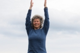 Jenny in Mountain Pose with arms extended overhead, palms parallel (Utthita Hasta in Tadasana) near the summit of Mount Tzouhalem, Vancouver Island, B.C. (Photo by Ian Hatter).
